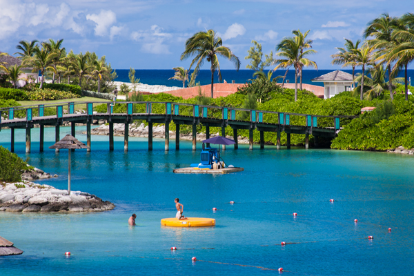 Nassau Bahamas, Grand Bahama, water playground, bridge with children playing in front on raft, lagoon, tropical day Caribbean